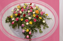 Exceptionally  Assorted Rose Casket Spray from Rick Anthony's Flower Shoppe in Lansing and Holt, MI