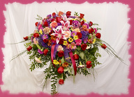 Rainbow Of Color Casket Spray from Rick Anthony's Flower Shoppe in Lansing and Holt, MI