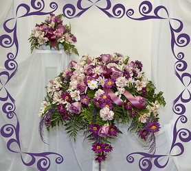 Purple and pink Casket piece with Matching Lid piece from Rick Anthony's Flower Shoppe in Lansing and Holt, MI