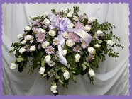 Casket spray in Lavender and White from Rick Anthony's Flower Shoppe in Lansing and Holt, MI