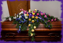 Stylized Colorful Casket Spray from Rick Anthony's Flower Shoppe in Lansing and Holt, MI