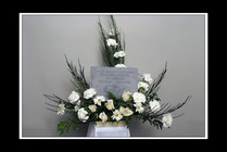 Memory Stone... When someone becomes a memory... in white from Rick Anthony's Flower Shoppe in Lansing and Holt, MI
