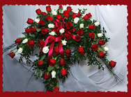 Red and White Rose Casket Spray from Rick Anthony's Flower Shoppe in Lansing and Holt, MI