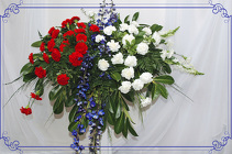 Red White And Blue Casket Spray from Rick Anthony's Flower Shoppe in Lansing and Holt, MI
